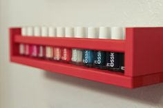DIY Nail Polish Rack - spray paint an IKEA spice rack whatever color you want! perfection.