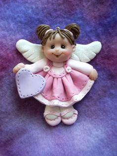 polymer clay angel angelic toddler child personalized Christmas ornament gift sculpture. $14.95, via Etsy.