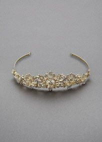 """A spectacular crown-like tiara for the bride who is looking for that bling factor!  Tiara featuresclear beading and crystals for that show stopping statement piece!  3"""" high. 15"""" long.  Available in Silver. Imported."""