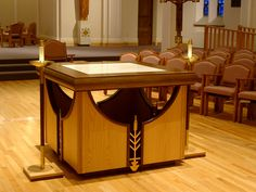 This altar was designed to complement the Romanesque arches of the SSND chapel in the provincial house in St. Louis. Gold finished wheat sections of the former communion rail are an integral part of the design whose lines focus on the action of the liturgy.