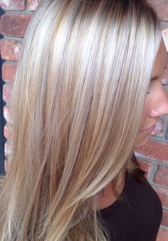 Platinum blonde hair with red lowlights