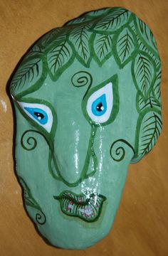 art, painted rock named Green Man
