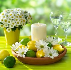 Lemons, daisies & a pillar candle in a low dish reception wedding flowers,  wedding decor, wedding flower centerpiece, wedding flower arrangement, add pic source on comment and we will update it. www.myfloweraffair.com can create this beautiful wedding flower look.