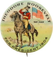Theodore Roosevelt Campaign Button. Classic San Juan Hill image with TR saluting astride his horse with American flag waving in the background.  *s*