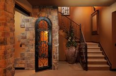Love the faux stone wall wrap around.  Great idea for basement