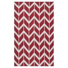 Bring visual appeal to your den or define areas in the living room with this hand-tufted wool rug, showcasing a chevron motif in red.