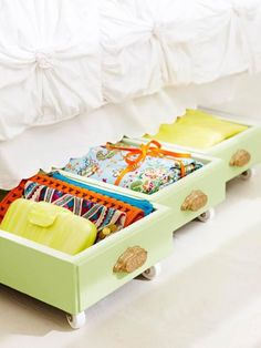 Upcycled drawers - Take your drawers off the shelves and under the bed with a bit of paint and added roller wheels. Fabulous organization tip!!