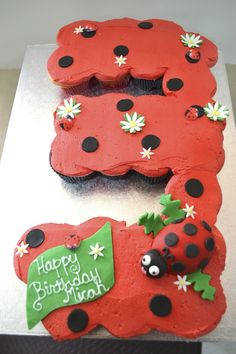 """It's a cupcake cake!  This lady bug themed """"cake"""" is made of 2 dozen of cupcakes."""