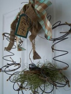 A SPRING Wreath - made using bed springs & jute.  This is a cute idea!