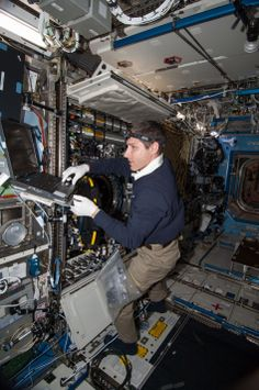 NASA astronaut Mike Hopkins, Expedition 38 flight engineer, performs in-flight maintenance on combustion research hardware in the Destiny la...