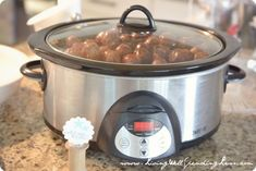 Sweet & Sour Crockpot Meatballs.  (aka Grape Jelly Meatballs!) Just 5 easy ingredients and 5 minutes of time, these meatballs are always the hit of any party or potluck!