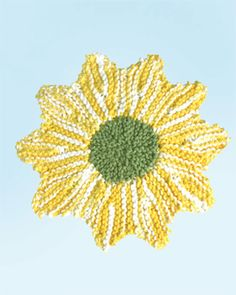 This pretty knit daisy dishcloth is sure to add a touch of floral fun to your kitchen decor. Shown in Lily Sugar 'n Cream.