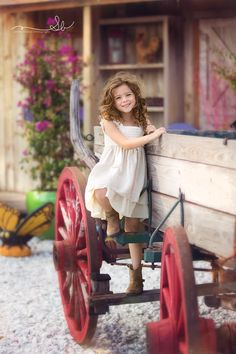This little girl is such a darling. Watch out for those country boys when you grow up sweet one.