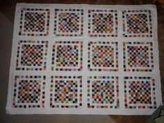 "100-Patch Quilt.  Each block has 100 2"" squares, then a white border and then a pieced border."