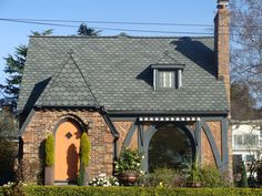 A brick tudor home would be delightful, though my front door would be blueberry or raspberry in color.