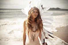 I don't know why but I just love native fashion like this.  I mean the headdress, the feathers, and the face-paint are just soooo awesome.