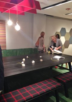 Working lunch, anyone? The @BuzziSpace BuzziPicNic bench is classic farmer cool meets modern tech. (Pro tip: the first table slat is designed at the perfect width to hold your iPad without it getting in your way!) NeoCon 2014