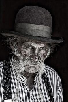 Old man, bowler, hat, beard, wrinckled, strong, intense, portrait, beauty, aged, worn, sadness, photograph, photo b/w.