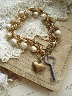 SENTIMENTAL - Antique Skeleton Key Jewelry. Vintage Key, Shabby Pearls, Brass Heart Charm Bracelet. Rustic Vintage Assemblage Jewelry.. 42.50, via Etsy.
