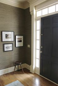 Dark front door with sidelights and transom
