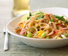 Chicken Pad Thai - This traditional Asian stir-fry is fast, easy, and flavorful. A perfect week night meal that combines chicken, bean sprouts, and rice noodles with a crunchy peanut topping.
