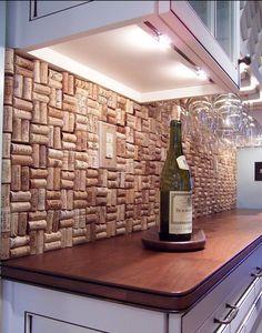 Wine cork backsplash. Great idea for a wet bar or message center, it doubles as a bulletin board!