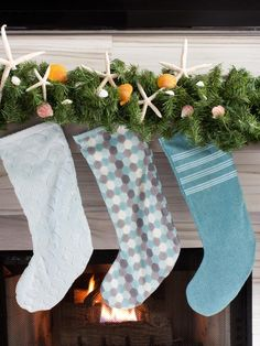 I'm still dreaming of this year's summer beach vacation. Anyone else??  Bring the coast to your #holiday home with sea-inspired decorations.  I repurposed these beach towels into adorable #Christmas stockings for HGTV's #HolidayHouse.  Get the stocking template at HGTV.com.