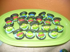 Super easy project.  Made from oreo cookies, green gumballs and pre-made fondant.  A big hit and adds such fun to your candy buffet. ninja turtle food ideas, birthday parti, oreo cooki, tmnt cookies, turtl parti, sewer lid cookies, parti idea