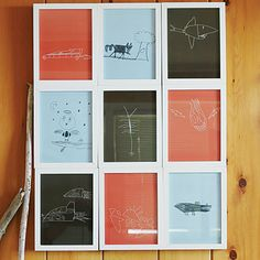 On the grid || Use a common color scheme and a grid of frames to unite children's drawings and other artwork for a singular display.