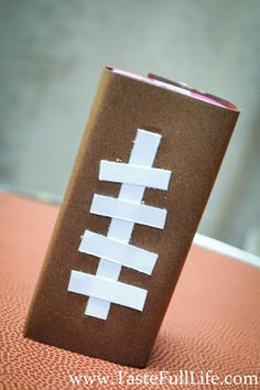 """""""football"""" wrapped juice boxes for a football birthday or Super Bowl party. OR Could do the same with candy bars for football theme shower favors?"""