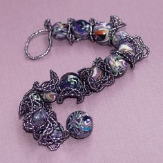Wild Grapes...  What better than this wild frilly purple bracelet for the last day of February!?  My birthday was the 28th, and I love purple; and I love these OOAK polymer clay beads by DDee Wilder.  :-)  $48