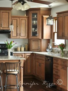 Kitchen remodel with wonderful wood cabinets. at Jennifer Rizzo (her mom's kitchen)