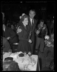 Joan Fontaine and Gary Cooper  holding their Oscars at the Academy Awards After Party, 1942