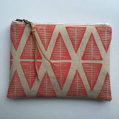 linocut printed fabric made into a clutch