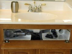 I've been planning on doing PVC pipe holders on the back of the cabinet doors. This seems even more brilliant by using wasted space! Amazon.com: Curling Iron Holder: Home & Kitchen $39.95