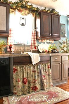 Country Living Kitchen  ~ love the gingham curtains and floral sink skirt