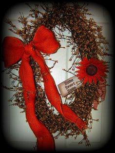 Gorgeous Wreath....Oval Shaped with Gold colored pip berries, Orange Burlap Bow and Flower. also has a tag that reads Home Sweet Home...I can personalize the tag...thank you for looking......$39.99 http://www.primitivehomedecorandmore.com/