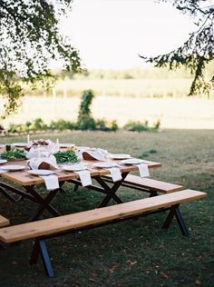 Simple yet ingenious. Using two picnic tables to make one very large square dining table. I love elevating a simple picnic table and bench set by painting the bases black.
