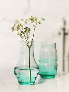 Wedding Reception Idea: Place a flower, tagged with your guests' names and table numbers, in each OLIK vase and give as placeholders/favors.