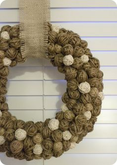 DIY Tutorial: Winter Wreath! This would be really fun to use all my yarn scraps for--and make a really bright, fun wreath.