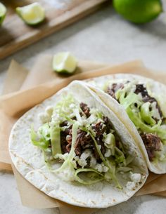 these Crockpot Short Rib Tacos with Salted Lime Cabbage and Queso Fresco are to die for. I howsweeteats.com