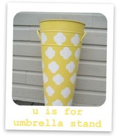 DIY umbrella stand looks like Ballard Design stand.