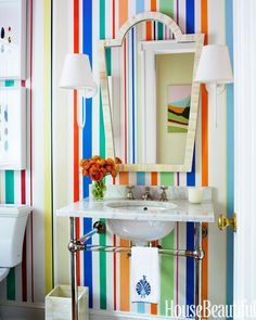 Hand-painted stripes in the bathroom add color and design
