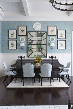 traditional dining room with gray banquette and blue chairs