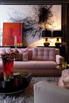 abstract art, pink sofa, brass lamps
