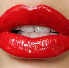 Glossy red lips.