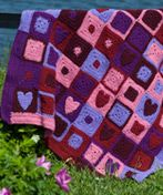 This Happy Hearts Afghan is just too cute - would be perfect for a little girl's room too.