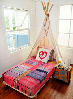 Teepee as a headboard - such a fun idea! Bohemian kids room boho