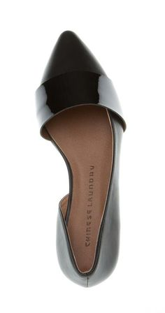 Pointed-toe flat features d'Orsay-inspired cutouts with a glossy patent-effect strap. @scrapwedo