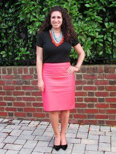 Black t-shirt, coral pencil skirt, & statement necklace